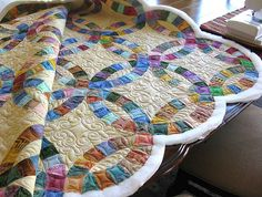Quilting by Carla Barrett on this double wedding ring quilt. Quilt is owned and pieced by Nancy Gwyn, Lenoir, NC.This shows the quilt before the binding.
