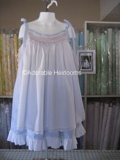"""This is the Irby pattern by Ruffle Bunnies [Sara Norris] Originally this dress is made up in all white, but I had to see it in color, so I used my favs which are white and blue. The under dress is a 1/8"""" alternating stripes of baby blue and white, in 100% cotton, and the over skirt is a tiny baby blue pin dot.  Can't you just picture it in pink, yellow, and green? All supplies available online and are in-stock!"""