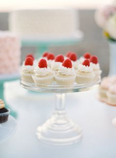 Cute cupcakes topped with a raspberry
