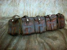 Vintage Leather Bandoleer Ammo Belt Steampunk Adventurer Bandolier Steam Punk LARP Cosplay WW2  Goggles. $84.00, via Etsy.