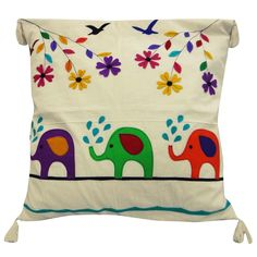 Cute pathwork #cushioncover in white cotton fabric with elephants made on the cushion along with floral detailing.