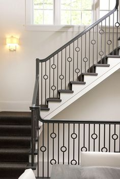 http://www.replacementmanufacturedhomeparts.com/railingchoices.php has some info on the types (materials) of stair railings that can be installed in manufactured homes.