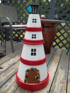 Lighthouse made out of terra cotta pots!! Solar light on top.