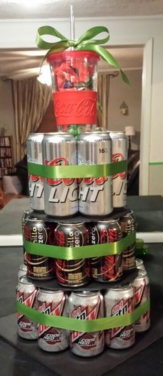 """A Sweetest Day gift for him! :) 30 cans, ribbon, a cup on top filed with M&Ms, and foam poster board (cut 8"""", 10"""", 12""""). He loved it! Valentine's or birthday he would've loved it all the same."""