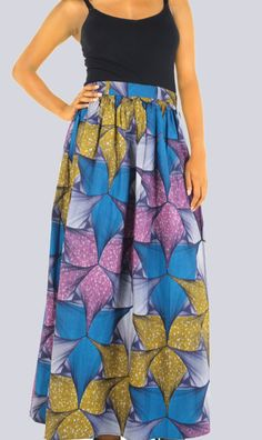 A stunning maxi, 100% cotton, batik skirt with a unique wax print. With a flattering high waist, this skirt really lengthens you so no need to wear your heels!  Available is UK sizes 8, 10 and 12 Average length 98cm - 103cm  Product code: K  NOTE: Although we try our best to match garment prints as shown in the pictures, prints on your item might be arranged slightly different. All items are hand-made and you will receive the same design in the same fabric. COLU WOMEN SIZE CHART…