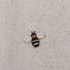 Small Bee Iron on Applique High quality, detailed embroidery applique. Can be sewn or ironed on. Great for hats, bags, clothing, and more! Size is approx. Embroidery On Clothes, Flower Embroidery Designs, Simple Embroidery, Hand Embroidery Stitches, Embroidery Applique, Cross Stitch Embroidery, Embroidery Monogram, Iron On Applique, Graphic