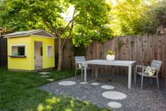 Modern outdoor furniture for the adults; cute yellow playhouse for the kids. 5456 Shafter, Oakland.