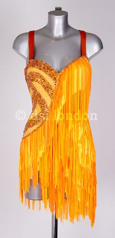 Eye-catching orange latin dress with fringe and moderate stoning - DSI London. Visit http://ballroomguide.com/comp/attire/lady.html for more info about competition attire.