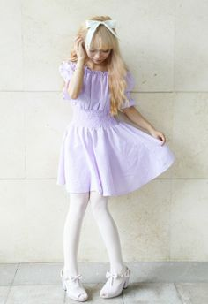 Loving that pastel purple dress. Goes really well with those white thights.