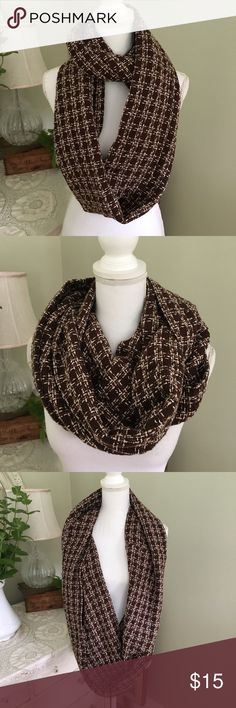 Handmade in Maine Brown Infinity Scarf This gorgeous brown infinity scarf has hints and shades of lavender and white throughout. Made by hand in Limerick, Maine. Accessories Scarves & Wraps