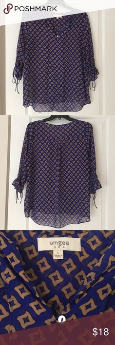 Shear patterned Umgee top Great shear blue and gold patterned top Umgee Tops
