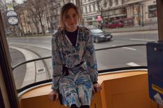 16.32 Miriam Stein riding the tram through Vienna - wearing the A Day in a Life Mountain Printed Silk Chiffon Shirt Dress and the Navy Ribbed Turtleneck Dress