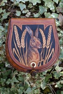 hand carved sporran with hare amidst ears of corn design and Celtic knotwork belt loop