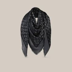 Monogram Shine Shawl This sophisticated shawl, woven with a tone-on-tone Monogram pattern, is given a subtle shimmer by the use of a soft shine yarn.