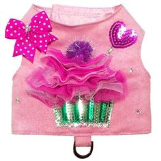 A delicious pink ultrasuede dog harness with a lace and sequin cupcake.