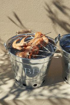This would be so awesome - every group of people have their own bbq bucket and have skewers on table with plates of shrimp/chicken/veggies to make their own on serving platter. For appetizers. Awesome Idea for Beach Wedding BBQ!!!