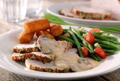 Varkensgebraad met champignonsaus en kroketjes