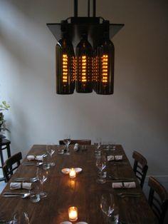 custom light fixture using wine bottles and grain of wheat lamps - Jonathan Foote