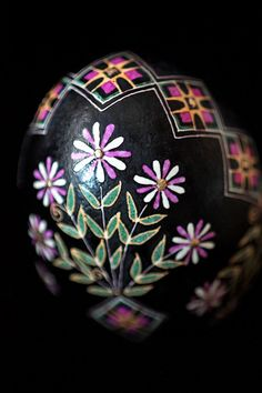 The central design on this pysanka are five flowers that stand alone (are not connected to each other).  This is a representation of the Tree of Life.  A plant in a vase standing on its own was also a highly abstracted version of the berehynia (great goddess).