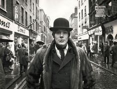 "Carnaby Street dandy, London, 16 April 1968 ""Fashionable male wearing a bowler hat and fur coat standing in the middle of the road on Carnaby Street in London in the heart of the 'Swinging Sixties'. Carnaby Street, London Street, London Life, Vintage London, Old London, Dandy, Swinging London, Bowler Hat, London Photos"