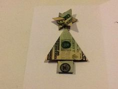 money origami  star: http://www.homemade-gifts-made-easy.com/money-origami-star.html  tree: http://www.homemade-gifts-made-easy.com/money-origami-christmas-tree.html