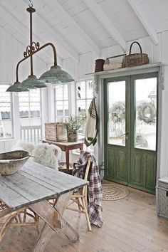 Swedish Farmhouse Style - Love those doors and the lights! Also the baskets everywhere.