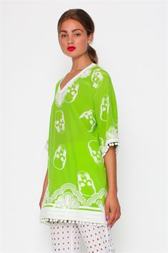 Compliments are guaranteed with this unexpected twist on a kaftan-style, printed with skull motifs. It is heavily embellished with embroidery along the hem and neckline and is trimmed with tiny pom poms. Size & Fit: Model is 177cm tall Model wears a NZ 8/ EU 36/ US 6 Wash Guide: Dry clean only. Select a high quality drycleaner. Gentle short cycle. Low moisture. Low temperature. Cool iron on reverse Fabric Composition: Main: 100% Silk