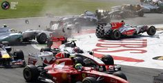 Vitantonio Liuzzi of Italy (R) crashes with other cars at the start of the Italian F1 Grand Prix at the Monza circuit September 11, 2011