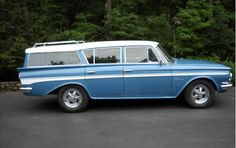 """I think this was the type of car we had when I was little, a Nash (AMC) Rambler, but ours was blue-green.  We called it Golunky, our child-view derivative of the words """"Go alone,"""" because once it backed down the driveway on its own and up onto the neighbor's yard!  We had a pretty cool song we made up about it, too."""