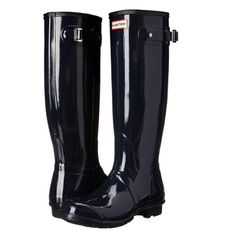 """Original Hunter Tall High Gloss Boots Original rain boots with a twist from Hunter. Made of super shiny lightweight rubber that's easy to fold and perfect for packing! Features textured bottoms for optimal traction on wet + dry surfaces and adjustable straps at the calf for the perfect fit. Finished with the brand's logo patch at the front.  Content + Care - Rubber - Wipe clean - Imported  Size - Heel height: 1""""  - Shaft height: 16"""" Hunter Boots Shoes Winter & Rain Boots"""