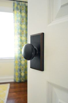 Love these interior door knobs with the big back plate. Come And Knob On Our Door | Young House Love