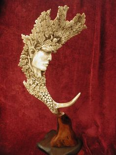 Gaia, the Earth Goddess: Hand carved deer antler. My husband wants a similar one carved out of moose antler, from Lloyd Studios #sculpture
