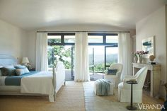 Muted furnishings showcase the view from the master bedroom.