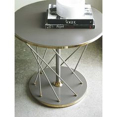 """Brushed silver rods, polished Gold Bullion accents and a Carbon Grey top and base create a dynamic, table that is truly a work of art! Modern Metro """"Art"""" is that perfect, round table to style a vignette and build a commanding focal point around. Round Side Table, End Tables, Table Topics, Modern Interior, Interior Design, Decoration, Modern Design, Interior Decorating, Beautiful"""