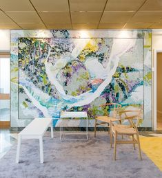 Beautiful modern office renovation Stockholm blue couch shelving orange carpet