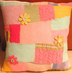 A pillow using scraps of felted wool sweaters. It was so much fun that I want to make another one. I got the idea from Betz White.