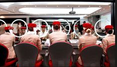 Flight attendant students for Emirates pose in the image and uniform classroom at the Emirates Aviation College in Dubai.    Emirates is ...