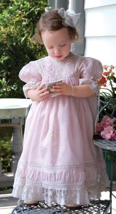 French heirloom dresses on little girls. Time to get out the lace and frilly things.