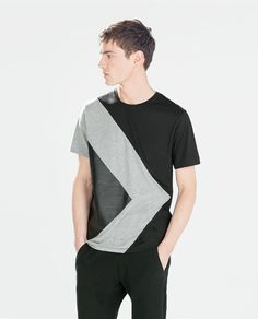Image 1 of T-SHIRT WITH FAUX LEATHER TRIANGLE DETAIL from Zara