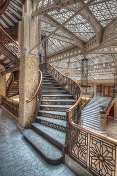 "The Rookery lobby, or ""light court,"" designed by Frank Lloyd Wright, has an airiness unlike any other skyscraper in the Financial District. The openness gives room to soften into the space. Our eyes get lost in the gorgeous geometric details repeated throughout, down to the smallest detail. architecture, building design, interior architecture, tessellation, historic architecture, Chicago, inspiration, stair design"
