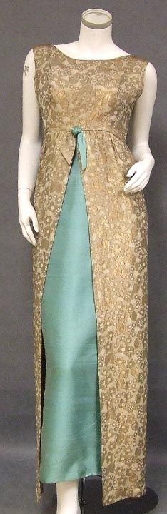 From Vintageous. Sarmi 1960's evening gown. Made of textured floral lame with fitted aqua underskirt.