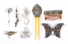 SIX PINS AND TWO HAIR COMBS 1) Branch-form, the oxidized met