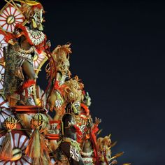 Revellers from the Academico do Salgueiro samba school perform atop a float