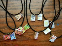 Mini Book Charm Necklace.  Made with 3/4 inch metal cabinet hinge with pictures of book covers printed on label paper that sticks on easily.  Inside the hinge is white label paper. I used an o-ring to attach the book on to an inexpensive pre-made cord necklace from local craft store. Easy and a big hit with my tweens. Tween library craft.