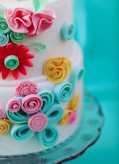 quilled cake. my ladies birthdays are coming up, maybe i could do a cake like this?!