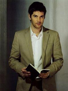 Jim Sturgess-holding a book