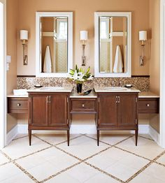 To create a custom look on a budget, these homeowners floated a stock drawer between a pair of vanities, creating a furniture-style look and more counter space: http://www.bhg.com/bathroom/type/master/every-style-master-suites/?socsrc=bhgpin050814chicaccents&page=14
