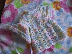 An extremely cute preemie baby dress  ~ LINK CORRECT and pattern is FREE when I checked on 04/08/2015.  ~ NO size mentioned