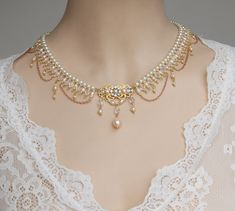 My best fantasy choker features white Swarovski pearls,pink cream rose FW pearls and clear AB crystals and three tiny golden chains are dangling bellow .In the center there is a golden filigree set with Swarovski Rhinestone and dangle pearls below it. Bridal Necklace, Rhinestone Necklace, Crystal Rhinestone, Pearl Necklace, Swarovski Pearls, Wedding Jewelry Sets, Bridal Jewelry, Beaded Jewelry, Cross Jewelry