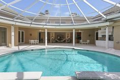 9 Country Club Road, 5 Bedrooms/ 6.5 Bathrooms. Enjoy tranquility relaxing by the pool with hot tub. Lush tropical surroundings on this large interior corner lot home;
